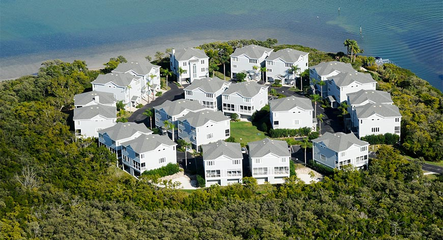 Aerial view of homes surrounded by mangroves near the gulf