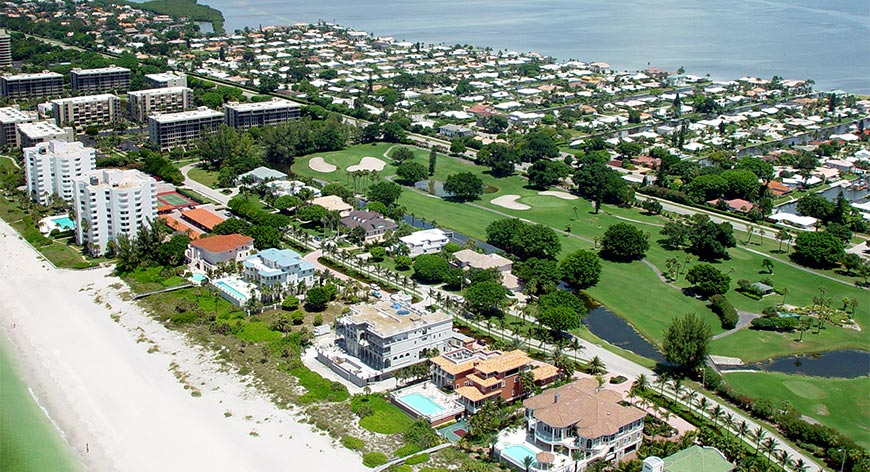 Aerial view of beach properties and golf course