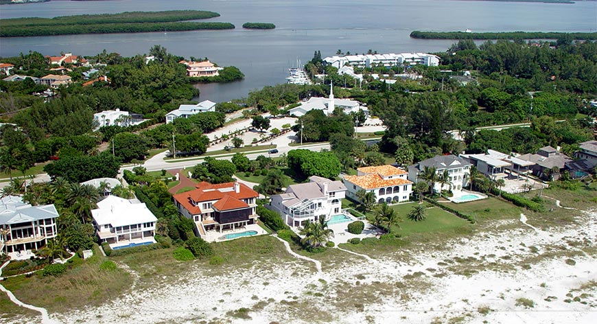 Aerial view of real estate on the gulf waters with bay in background